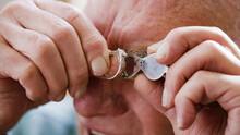 Senior Jeweller Checking A Ring