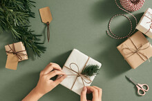 Female Hands Decorating Presents At Christmas. Christmas Concept.