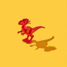 Plastic Model Of Dinosaur With Shadows.