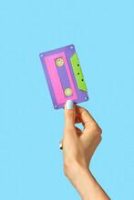 Hand Holds Handmade Paper Cassette.