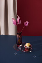 Delicious Fresh Red Velvet Cake And Crystal Vase With Small Bud Of Gardenia On Yellow Minimalistic Background