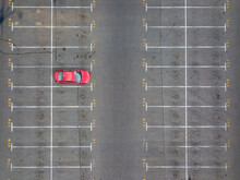 Asphalt Empty Parking Numbered With One Red Car.