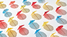 Creative Pattern From Multicolor Cocktail Umbrellas.