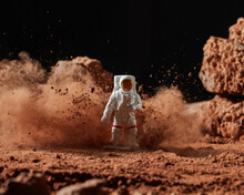 Cloud Of Cocoa Powder Around Spaceman.
