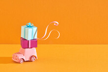 Gift Boxes On Toy Vintage Car