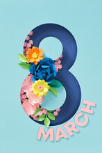 Card For 8 March Womens Day. Flowers Inside Number Eight Cut From Paper