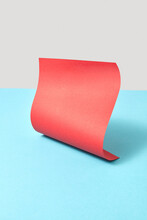Vertical Red Curved Paper Sheet.