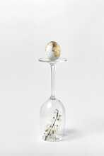 Easter Golden Egg On A Glass With Flowers.