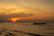 Natural Marine Landscape With Boat And Sun Is Setting Over Color Clouds On Philippines.