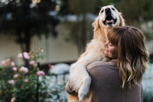 Woman Hugging A Dog
