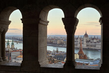 View Through Stone Arches To Sityscape Of Budapest, Hungary.