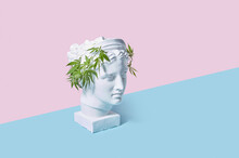Plaster Diana Head With Marijuana Wreath.