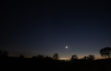 Evening Sky With Crescent Moon At Sunset Over Lake Folsom And The Central Valley