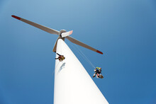Repair Work On The Blades Of A Windmill For Electric Power Production - Copy Space