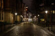 Düsseldorf, Germany - NOVEMBER 2020:Night scenery silent walking street with closed shop, cafe and restaurant in old town during lockdown from epidemic COVID-19 in Düsseldorf, Germany.