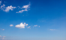 Clear Blue Sky With Single Cumulus Cloud. (For Abstract Background Uses)
