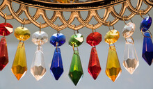 Beautiful Hanging Crystal Beads (closeup) Of Various Colors Such As Red, Yellow, Blue, Green And White. (For Background Uses)