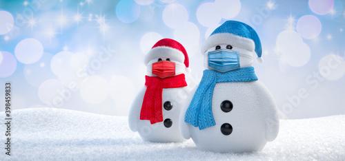 Fotografie, Obraz Two snowmen with face protection masks - 3D illustration