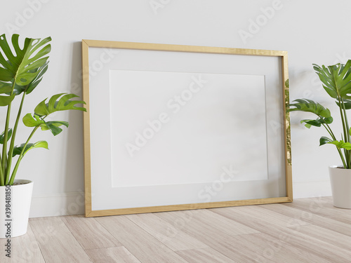 Fototapeta Golden frame leaning on floor in interior mockup. Template of a picture framed on a wall 3D rendering obraz