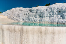 The Sparkling White Terraces Of Shallow Limestone Pools Filled With Azure Blue Water At  Pamukkale, Turkey