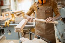 Carpenter Folds Wooden Bars Together At The Workshop, Close-up On Hands