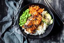 Bowl OfÔøΩteriyakiÔøΩsalmon With Rice, Carrot Salad,ÔøΩedamameÔøΩbeans, Avocado And Sesame Seeds