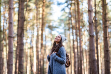 Smiling Female Hiker Exploring In Cannock Chase Woodland
