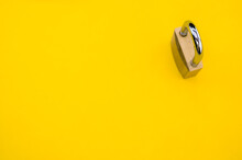 Top View Of A Padlock Isolated On Yellow Background