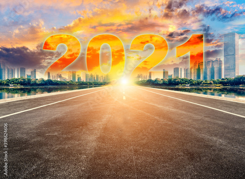 Fototapeta Straight ahead to the modern city with the New Year 2021 concept. The 2021 number written in modern cities. obraz
