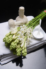 Spa Concept With Bunch Of Tuberose Flowers ,buds On Towel, Cream In Bowl And Herbal, Ball,