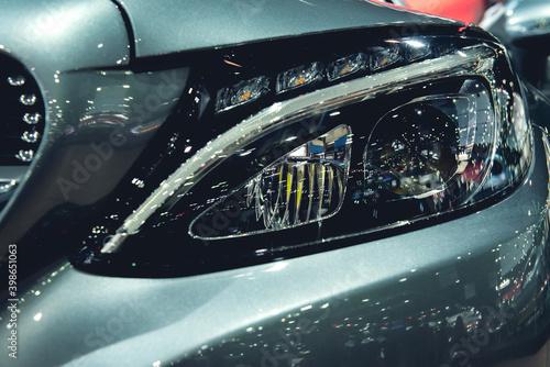 Fototapeta Headlight of a modern luxury car, auto detail,car care concept ,daytime running light obraz na płótnie