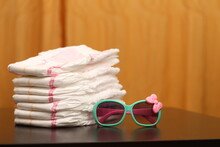 White Baby Diapers With A Pink Stripe. Side View