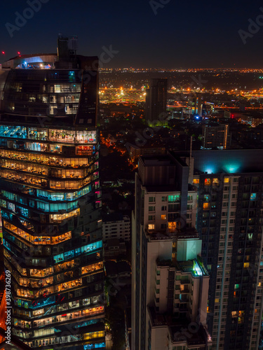 Fototapeta Bangkok highrise office building and apartment with light illumination at night time. obraz na płótnie
