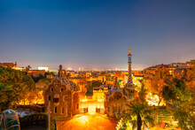 Barcelona At Night Seen From Park Guell. Park Was Built From 1900 To 1914 And Was Officially Opened As A Public Park In 1926. In 1984, UNESCO Declared The Park A World Heritage Site