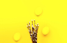 Illuminating Yellow Easter Eggs And Willow Branches On Yellow Background. Festive Concept. Trendy Color 2021. Creative Copy Space.