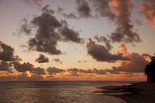 Cloudscape Over Ocean And Island At Sunset
