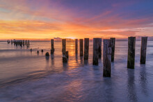 Sunset At The Pier. Famous Old And Historic Naples Pier Florida America. Travel And Nature Concept Usa.