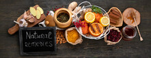 Healthy Products For Immunity Stimulating And Cold Remedies On Wooden Table