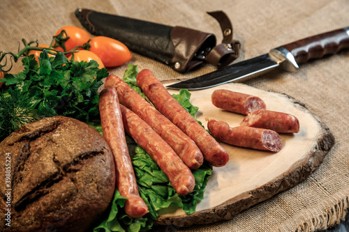 Fotografie, Obraz sausages on a wooden board