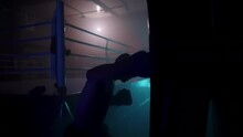 Boxer In The Boxing Gym. Bandages His Hands. Sparring In The Ring. Boxer Jumping Rope. Exercise With Ropes. Round One. Fog In The Ring. Zetsky Sport. Beautiful Backlight. World Boxing Champion.