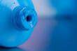 Tube of opened blue acrylic paint