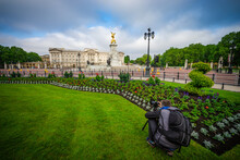 Photographer Taking Picture Of Buckingham Palace Using DSLR Camera With Tripod And Lens Filters