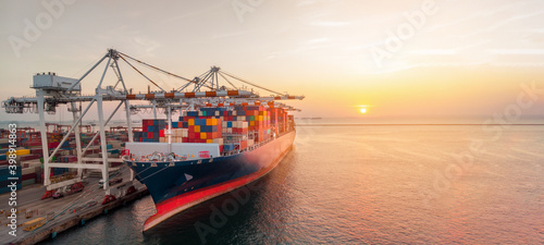 Canvas Print Crane loading cargo container to container ship stand by in the international te