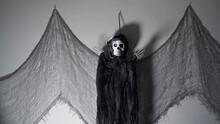 Death, Skeleton In Black Hooded Robe, On White Background