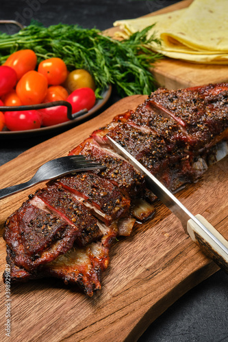 Leinwand Poster Grilled lamb breast and flap on wooden cutting board