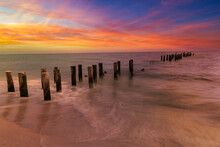 Sunset On The Beach. Old Naples Pier Florida
