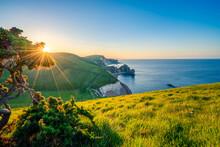 Beautiful Sunrise Near Jurasic Coast Known As Durdle Door In England, UK