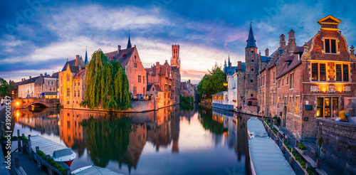 Fotografija Sunset panorama of center of Bruges, often referred to as The Venice of the North, with famous Rozenhoedkaai