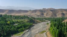Panoramic View Of Shahristan River With Zeravshan Mountain Range In Background, Near Bunjikat Sogdian Ruins In Sughd Region, Tajikistan