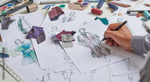 Foto Fashion designer stylish drawings sketches textile fabric material Costume